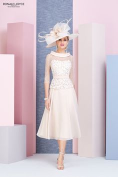A tea length chiffon dress with a detailed flower appliqued bodice, illusion ¾ length sleeves and elegant chiffon bateau neckline. Mother Of The Bride Fashion, Mother Of Bride Outfits, Mother Of The Bride Gown, Mother Of Groom Dresses, Bride Groom Dress, Mothers Dresses, Tea Length Wedding Dress, Tea Length Dresses, Colored Wedding Dresses