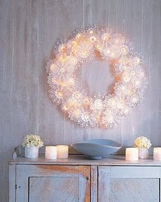 Wreath decor with lights and doilies.