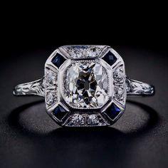 Diamonds and sapphire in platinum art deco ring