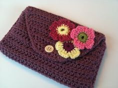 Link busted but looks hackable.  Long rectangle crocheted with double crochet, tapered on one end, then folded in thirds and stitched on the sides.  Lots of flower motif charts available on the interwebs for stitching the trim.