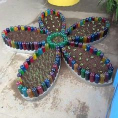 Discover thousands of images about Wine bottle gardening Recycled Garden Art, Eco Garden, Garden Crafts, Diy Garden Decor, Recycled Crafts, Garden Projects, Plastic Bottle Planter, Reuse Plastic Bottles, Plastic Bottle Crafts
