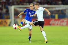 Andrea Conti of Italy and Max Meyer of Germany battle for the ball during the 2017 UEFA European Under-21 Championship Group C match between Italy and Germany at Stadion Cracovia on June 24, 2017 in Krakow, Poland.