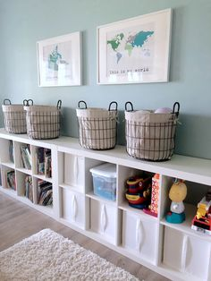 An Organized Playroom - Love the cubby shelves and metal baskets for toy storage, and the map art on the wall is so cute! #toystorage #playroom #organization #organizedtoys
