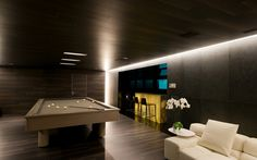 modern billiard room with bar and sitting area in black
