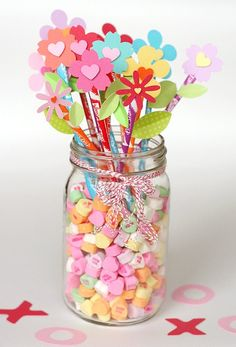 What a great little center piece/party favor.  Pixy stix bouquet with conversation hearts at the base!  Too cute!