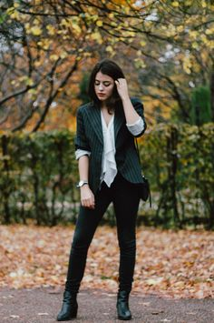 Combining a black vertical striped blazer with black skinny jeans is a nice option for a casual but seriously chic ensemble. Complement your look with black leather ankle boots to up the glamour factor. Black Leather Ankle Boots, Leather Booties, Black Suede, Striped Blazer, Vertical Stripes, Looking For Women, Blazer Jacket, Black Tops, Skinny Jeans