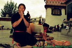 The local Tibetan woman are making Tashi delek gesture.