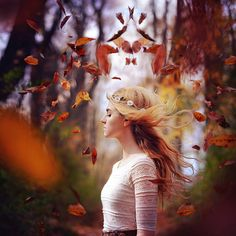 October by Rachel Baran | Falling leaves in fall, this woman looks so peaceful with her flowing hair! #peaceful