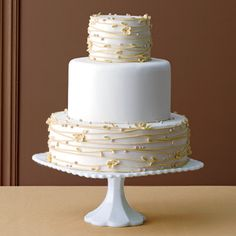 Brides: Wedding Cake with Vines and Flowers. Tiers of Joy
