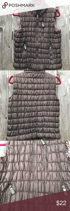 "NWOT Essentials by Milano quilted vest Vest is marked XL but it fits like a true medium. Beautiful animal print lining.  Zip front and 3 pocket zippers are sturdy.  Bust 40"" Center back length 22  Hem opening 42 essentials by milano Jackets & Coats Vests"
