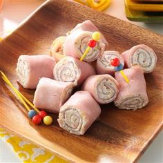 Ham 'N' Cheese Pinwheels Recipe -This recipe is a convenient make-ahead snack. I love the garlic flavor in these roll-ups. Every time I serve them, they're a hit. —Andrea Bolden, Unionville, Tennessee