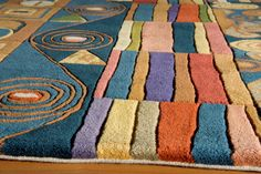 Hand-tufted by expert artisans using a special blend of the highest quality Chinese wools, these rugs have the softest of hands and a shine that is unsurpassed. Many New Wave designs feature hand carving for added depth and a Tibetan-like weave, mostly found in hand-knotted rugs, but expertly achieved in these hand-tufted pieces.