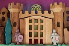 The Castle Keep   Flickr Wooden toys Knights painted too. That bush looks like a fire flame. Oh my!