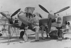 """""""Check out the snakes heads [sic] under the propellers."""" flown by Major Willard Webb being loaded with 'bazooka tube' rockets, Chittagong, India, Fighter """"Twin Dragon"""" Squadron. Ww2 Aircraft, Military Aircraft, Aircraft Images, Air Fighter, Fighter Jets, Lockheed P 38 Lightning, Ww2 Pictures, American Fighter, Vintage Airplanes"""
