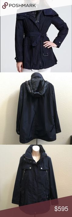 Auth Burberry Brit Navy Belted Anorak Jacket 10 This is a beautiful authentic Burberry Brit navy Anorak. Size 10 US. Worn once no flaws. Zips closed with snaps on top. Multiple pockets in the front with zippers. Burberry Jackets & Coats Trench Coats