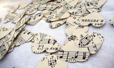 Sheet music confetti hearts for centerpieces! Can buy 12x12 paper and hole punch them yourself. I'd like them in the shapes of birds, though.