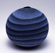 Matsui Kosei ^ uses the technique Neriage, which mixes different color clays.   Neriage: http://ceramicartsdaily.org/pottery-making-techniques/wheel-throwing-techniques/you-say-neriage-i-say-nerikomino-matter-what-you-call-it-mixing-colored-clays-makes-for-gorgeous-pottery-surfaces/  Living National Treasure: https://ibarakey.wordpress.com/2013/04/16/living-national-treasure-matsui-kosei-%EF%BC%8D-a-retrospective/