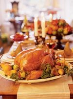 The star of the holidays is roast turkey, glazed and tender and encircled by fresh herbs and fruits.