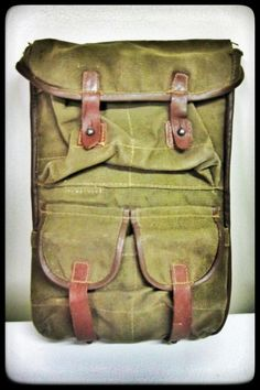 Vintage army canvas & leather ammo pouch used originally by Soviet Bloc countries for PSL  or Dragunov magazines in front, full pouch space behind for mag discards or other gear...