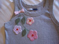 flower embellishment on plain tee
