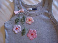 flower embellishment on plain tee