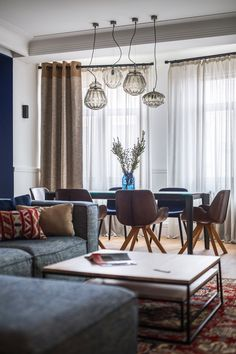 Mixture of wood, glass & fabric. Cool. An Upscale Ukrainian Apartment for the Classy Homeowner