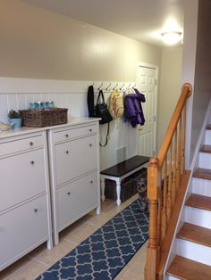 townhouse entryway mudroom with ikea hemnes shoe cabinets hooks bench and baskets