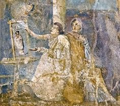 """artist unknown """"Painter Completing a Portrait."""" This scene is from the 1st century CE, a wall painting from the ancient city of Pompeii (region VI, insula 14, building 42.) It depicts a female painter completing a portrait while another woman looks on."""