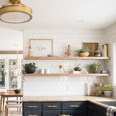 I'm thinking about rearranging the shelves. The lemon button fern isn't looking quite as full (what am I doing wrong?), so the right side of both shelves look a bit off. What do you guys think? Maybe go with more dishes and less stuff? #currenthomeview http://liketk.it/2q8fd @liketoknow.it #liketkit