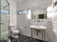 68 Boundary Road, Bardon // Mario Sultana #bathroom #bathroominspiration #homeinspiration #neutral #tiles #sink #home #homedecor #brisbane #queensland #realestate #inspiration #homedecorate #realestate #realtor #brisbanerealestate #decorator #interiordesign #modern #crisp #light #open #space