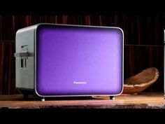 A Purple Toaster Which Works Like Oven Made Of Glass