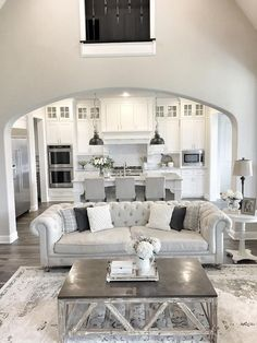 Open layout homes are timeless, allowing for a sense of flow throughout the home. Click on image to see more living room ideas and designs.