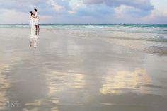 Newlyweds on the beach for a trash the dress shoot in the Riviera Maya. Playa del Carmen, Mexico wedding photographers Del Sol Photography.