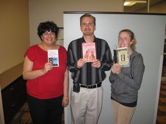 Anissa with To Kill a Mockingbird, Ron with Are You there God? It's Me, Margaret, and Melissa with Animal Farm