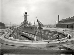 "Circa 1910. ""Brooklyn Navy Yard, dry dock No. 4."" The battleship is the USS North Dakota BB-29. Detroit Publishing glass negative."