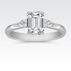 Three-Stone emerald cut center with Pear-Shaped side Diamond Engagement Ring