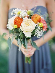 pretty bridesmaids bouquet - love the orange against the grey dress