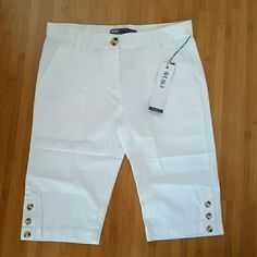 NEW! Lija white Chino shorts Bermuda knee length New White Riviera chino cotton shorts with cute button detail at the knee hem. 100% cotton. Favorite in golfing apparel. Measurements off of a size 4 are waist 15.5. Rise 10 inches and inseam is 12. CURRENTLY ON AMAZON SOLD OUT OF WHITE AND SELLING FOR $54. Lija Shorts Bermudas