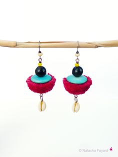 Pom-pom earrings ! Ethnic chic dangling earrings, tassels, coco, natural seeds and cowries.  Available in my shop.  © Natacha Fayard