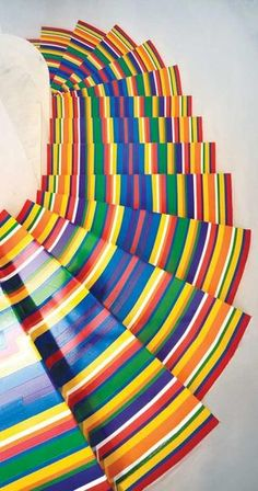 "Colorful Vinyl Tape Striped Stairs by Jim Lambie = ""Zobop (Metallic Color Stairs)"" from 2005."