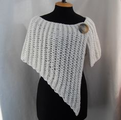 This stylish wrap will warm you up in fall season. It can be the perfect wedding accessories for brides or bridesmaids. You will look great with this beautiful wrap. You can wear it with everything you like: dress, skirt, trousers, shirt etc. This is wrap from yarn, which consists of 50% wool and 50% acrylic. Size: M - L (US 8 - US 12) (width of shoulder- from 16 to 18). Measurements: length of the corner (front of the wrap) - 20; length the wrap on the back - 10. How to care: Hand wash in…