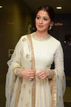 The lovely Raai Lakshmi is seen here at the audio launch of Telugu film Kotikokkadu. The south beauty looked ethereal in a cream Sabyasachi creation....