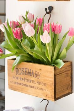 Spring tulips in hanging herb crates and other beautiful way to lighten up your home decor for spring...