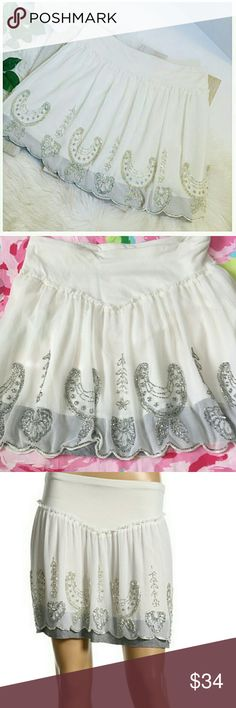 """Free People Silver Beaded Miniskirt Free People silver beaded miniskirt size large. Elastic waist. Tulle front layer. Silver beading. Sequins.  Grey jersey trim detail.  A few missing beads but not noticeable. Waist: 30-34"""". Length: 16"""". (#G6521). Free People Skirts Mini"""