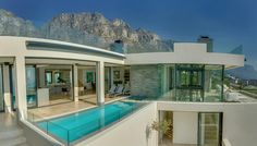 Designed by Gert Weideman. Featured on Top Billing. Backdrop of the Twelve Apostle mountains surrounded by nature. Open plan living.  #TopBilling #CampsBay #PamGolding