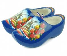 Fine crafted wooden shoe clogs Made In Holland feature graphic of classic Dutch scene on a rich blue painted clog. These wooden shoes are made of light weight, durable and high quality poplar wood. Pl