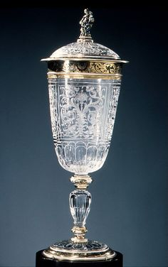 Cup, Covered  Reinhold Vasters (German, Erkelenz 1827–1909 Aachen)  Artist: Finial figure after a composition by Abraham Lotter the Elder (died 1612) Date: 19th century Culture: German Medium: Rock crystal, enameled gold Dimensions: H. 10-1/2 in. (26.7 cm) Classification: Natural Substances-Rock Crystal Credit Line: Bequest of Benjamin Altman, 1913