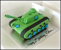 3D Army tank cake. Dark chocolate mud cake with dark chocolate ganache filling. Iced and decorated in fondant and royal icing.