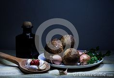 Still life with mushrooms,  black bottle with olive oil, onion, garlic and pepper