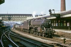 LMS Class 5 4-6-0 no. 45329 on an up freight, and a cross-country DMU on a service to South Wales.   2nd April 1965